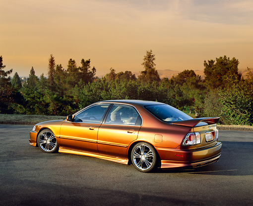 AUT 25 RK1260 06 © Kimball Stock 1996 Honda Accord DX Custom Bronze 3/4 Rear View On Pavement Trees Background