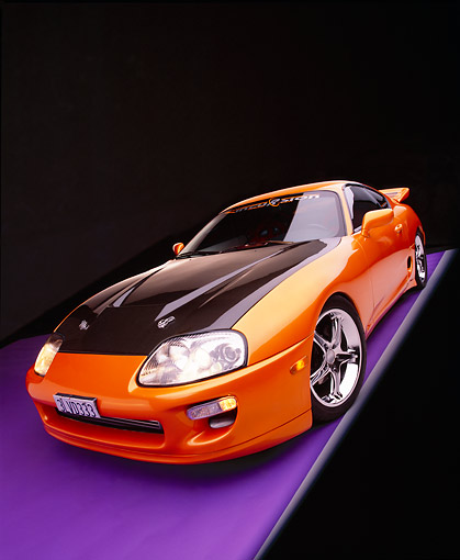 AUT 25 RK1268 17 © Kimball Stock 1995 Toyota Supra Custom Orange And Black Wide Angle 3/4 Front View On Purple Floor Gray Line