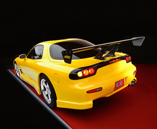 AUT 25 RK1291 08 © Kimball Stock 1993 Mazda RX7 Yellow Custom Wide Angle
