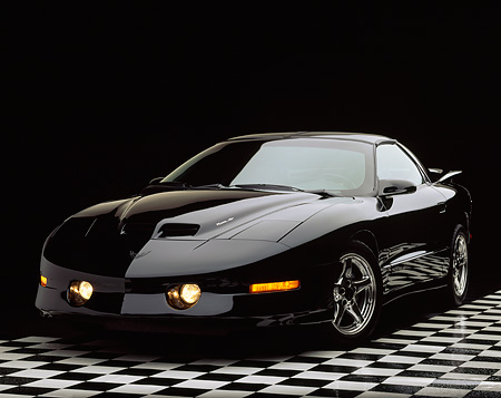 AUT 25 RK0019 07 © Kimball Stock 1997 Pontiac Firebird Trans Am WS-6 Black 3/4 Front View On Checkered Floor Studio