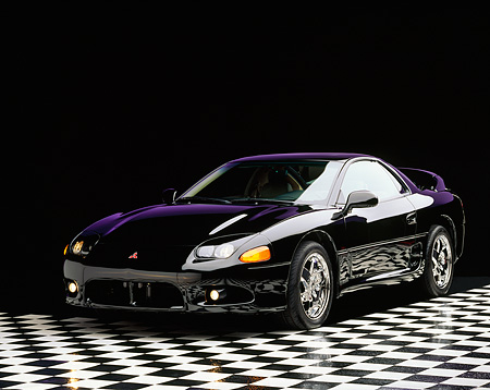 AUT 25 RK0020 01 © Kimball Stock 1997 Mitsubishi 3000GT Black 3/4 Front View On Checkered Floor Studio
