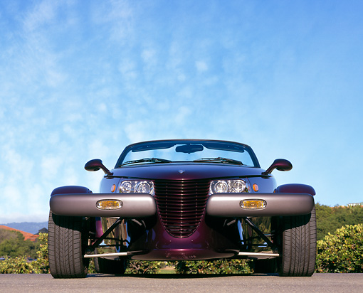 AUT 25 RK0071 02 © Kimball Stock 1998 Plymouth Prowler Roadster Burgundy Low Head On Shot On Pavement Blue Sky