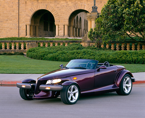 AUT 25 RK0078 03 © Kimball Stock 1998 Plymouth Prowler Roadster Burgundy 3/4 Front View On Pavement By Grass And Trees