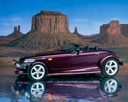 AUT 25 RK0079 06 © Kimball Stock 1998 Plymouth Prowler Roadster Burgundy 3/4 Side View On Mylar Floor Rock Mountains Studio