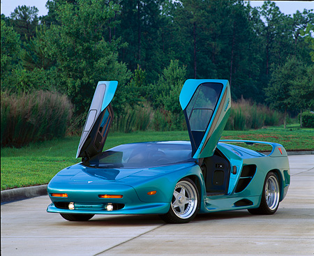 AUT 25 RK0097 01 © Kimball Stock 1992 Vector Avtech WX-3 Supercar Turquoise 3/4 Front View Doors Open On Pavement By Grass And Trees