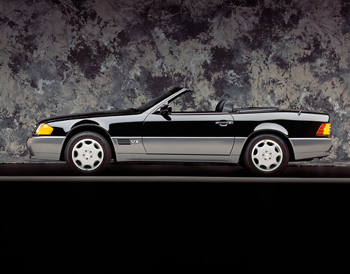 AUT 25 RK0201 05 © Kimball Stock 1994 Mercedes-Benz 600SL Roadster Black Profile View On Gray Line And Background Studio