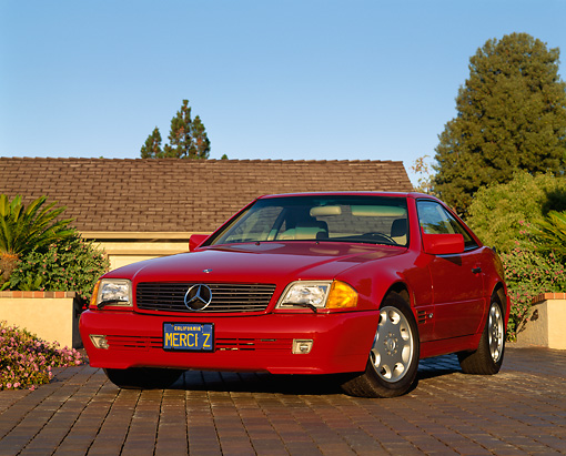AUT 25 RK0203 02 © Kimball Stock 1994 Mercedes-Benz 600SL Roadster Red 3/4 Front View On Driveway By House