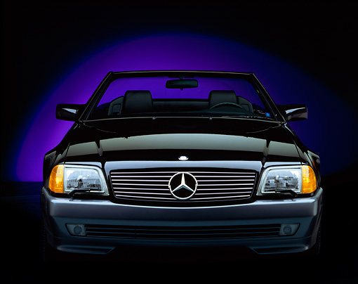 AUT 25 RK0219 01 © Kimball Stock 1992 Mercedes-Benz 500SL Convertible Black Head On Shot Purple Shade In Background