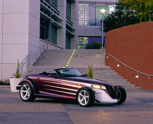 AUT 25 RK0254 07 © Kimball Stock 1998 Plymouth Prowler Pruple 3/4 Side View By Stairs