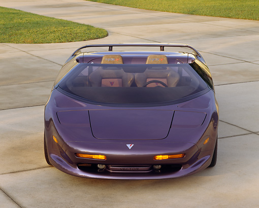 AUT 25 RK0262 09 © Kimball Stock 1993-94 Vector Avtech Roadster Purple Head On Shot On Pavement