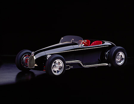 AUT 25 RK0284 04 © Kimball Stock 1996 California V-8 Special Black Roadster Custom Black 3/4 Side View On Black Floor Studio