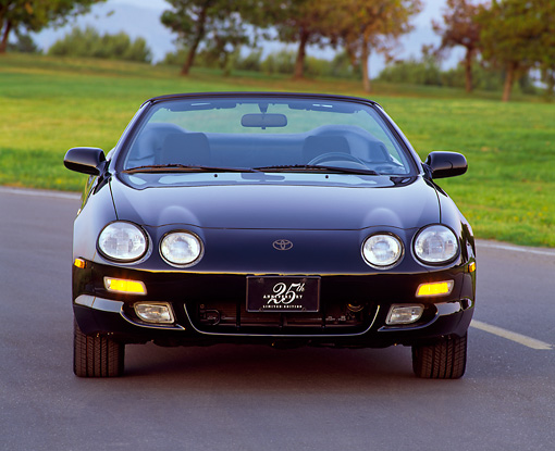 AUT 25 RK0286 02 © Kimball Stock 1996 Toyota Celica 25th Anniversary Convertible Blue Head On Shot On Pavement