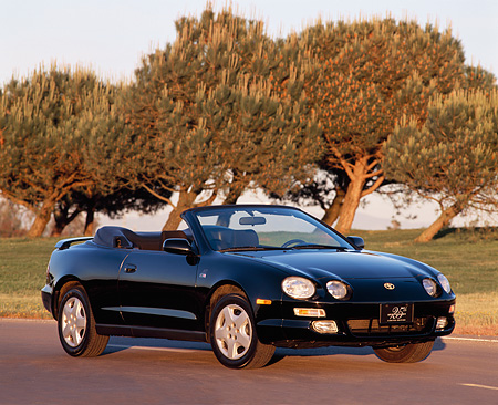 AUT 25 RK0289 04 © Kimball Stock 1996 Toyota Celica 25th Anniversary Convertible Black 3/4 Front View By Trees