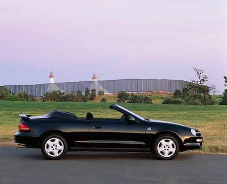 AUT 25 RK0290 01 © Kimball Stock 1996 Toyota Celica 25th Anniversary Black Profile On Road By Shoreline At Dusk