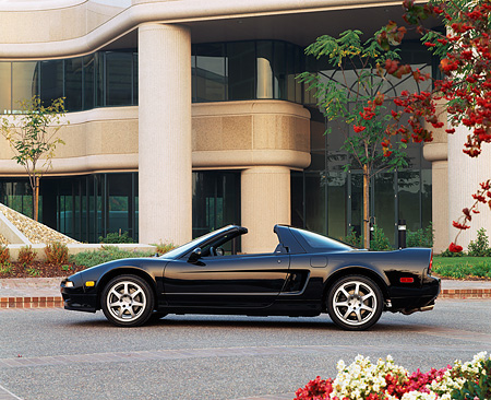 AUT 25 RK0325 08 © Kimball Stock 1996 Acura NSX Black Profile View On Pavement By Building