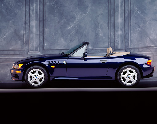 AUT 25 RK0336 01 © Kimball Stock 1996 BMW Z3 Convertible Blue Side View On Gray Line Marble Background