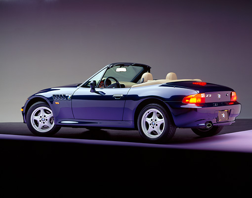 AUT 25 RK0343 01 © Kimball Stock 1996 BMW Z3 Convertible Blue 3/4 Rear View On Purple Floor Studio