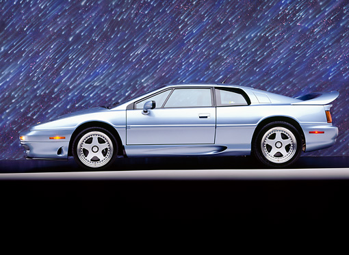 AUT 25 RK0353 06 © Kimball Stock 1995 Lotus Esprit S4S Silver Side View On Gray Line Showering Stars
