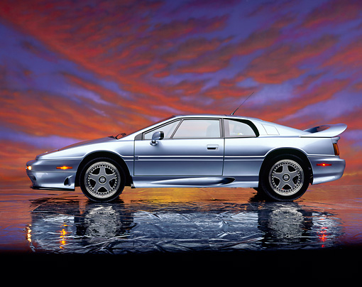 AUT 25 RK0354 02 © Kimball Stock 1995 Lotus Esprit S4S Silver Side View On Mylar Floor Sunset Clouds Studio