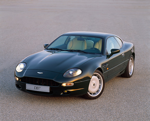AUT 25 RK0366 01 © Kimball Stock 1995 Aston Martin DB7 Green Overhead 3/4 Front View On Pavement