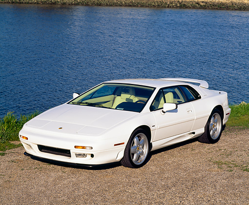 AUT 25 RK0409 05 © Kimball Stock 1995 Lotus Esprit S4 White Front 3/4 View By Water