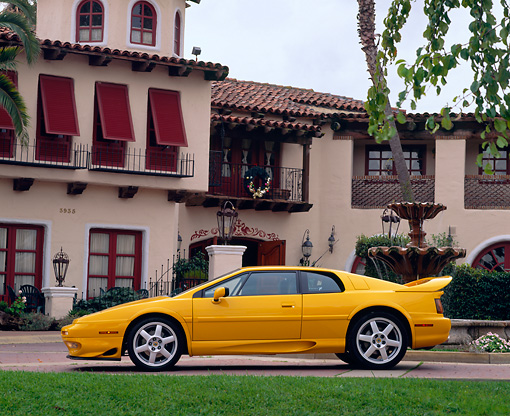 AUT 25 RK0431 04 © Kimball Stock 1997 Lotus Esprit V8 Yellow Profile View By Spanish Building