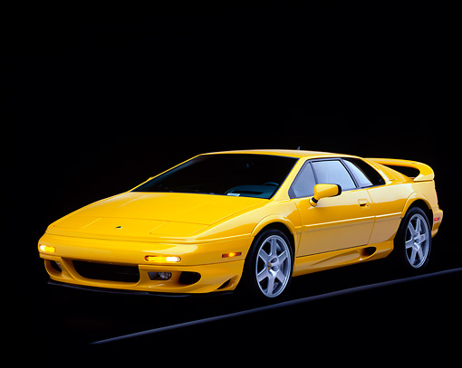 AUT 25 RK0435 01 © Kimball Stock 1997 Lotus Esprit V8 Yellow Front 3/4 View On Gray Line Studio