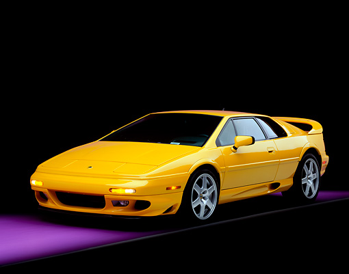 AUT 25 RK0436 07 © Kimball Stock 1997 Lotus Esprit V8 Yellow Front 3/4 View On Purple Floor Studio