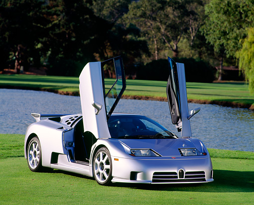 AUT 25 RK0442 11 © Kimball Stock 1994 Bugatti EB110 SS Silver Doors Open 3/4 Front View On Grass By Pond