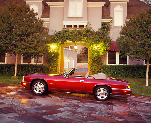AUT 25 RK0464 01 © Kimball Stock 1995 Jaguar XJS Convertible Profile View On Driveway At Night