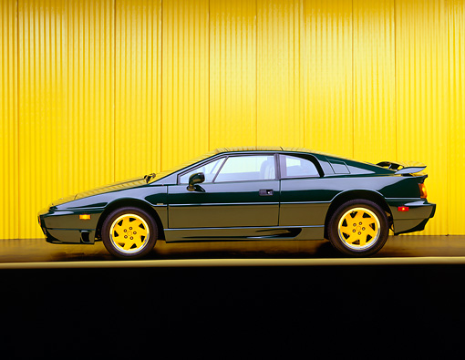 AUT 25 RK0468 02 © Kimball Stock 1991 Lotus Esprit Turbo Green Side View Yellow Line And Background Studio