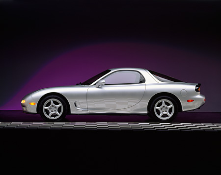 AUT 25 RK0469 01 © Kimball Stock 1992 Mazda RX7 Silver Profile View On Checkered Line Studio