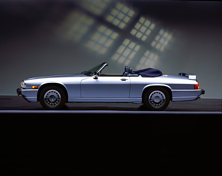 AUT 25 RK0591 05 © Kimball Stock 1990 Jaguar XJS Sport Convertible Blue Profile On Gray Line Grphic Background