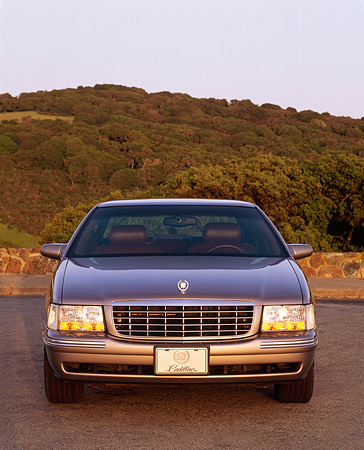 AUT 25 RK0708 04 © Kimball Stock 1998 Cadillac De Ville Champagne Head On Shot Hills Blue Sky