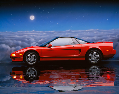 AUT 25 RK0721 01 © Kimball Stock 1990 Acura NSX Red Profile View On Mylar Floor Cloudy Night Sky Background Studio