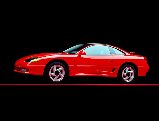 AUT 25 RK0735 01 © Kimball Stock 1991 Dodge Stealth R/T Turbo Red 3/4 Side View On Red Line Studio