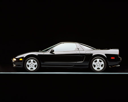 AUT 25 RK0742 02 © Kimball Stock 1991 Acura NSX Black Profile View On Gray Line Studio
