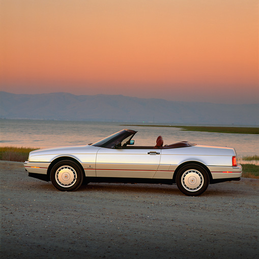 AUT 25 RK0786 11 © Kimball Stock 1990 Cadillac Allante Convertible Silver Side View By Water Filtered