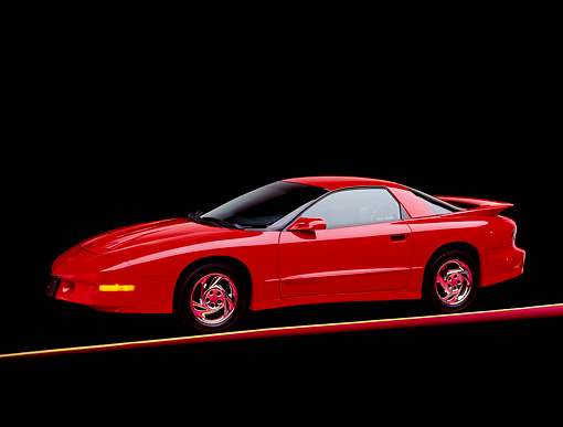 AUT 25 RK0838 04 © Kimball Stock 1993 Pontiac Firebird Trans Am Red 3/4 Side View On Red And Yellow Lines Studio