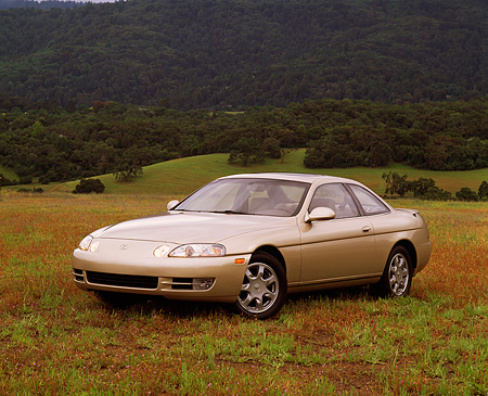 AUT 25 RK0903 14 © Kimball Stock 1994 Lexus SC400 Gold 3/4 Front View On Grass Hill