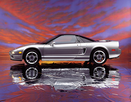 AUT 25 RK0912 04 © Kimball Stock 1993 Acura NSX Silver Profile View On Mylar Floor Sunset Background Studio