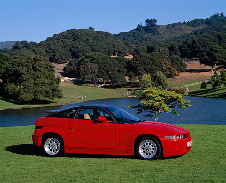 AUT 25 RK0945 03 © Kimball Stock 1989 Alfa Romeo Sprint Zagato Red 3/4 Front View On Grass By Lake