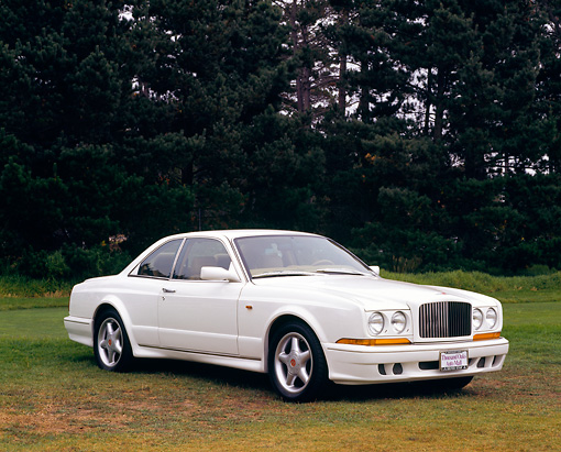 AUT 25 RK0948 02 © Kimball Stock 1997 Bentley Continental White 3/4 Front View On Grass