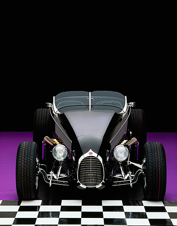 AUT 25 RK1052 02 © Kimball Stock 1999 Moal Special Roadster Black Head On View On Checkerboard And Purple Floor Studio