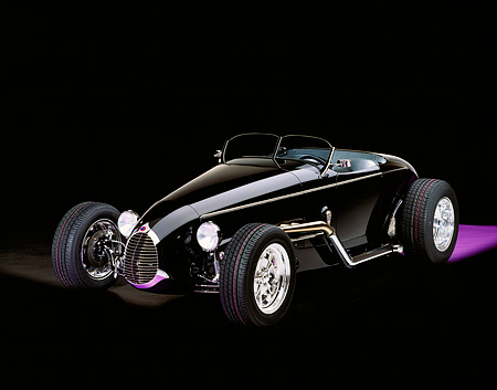 AUT 25 RK1056 05 © Kimball Stock 1999 Moal Special Roadster Black 3/4 Front View On Purple Floor White Lighting Studio