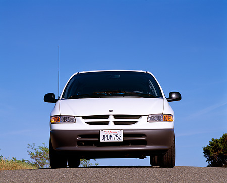 AUT 25 RK1058 04 © Kimball Stock 1996 Dodge Caravan White Low Head On Shot On Pavement Blue Sky