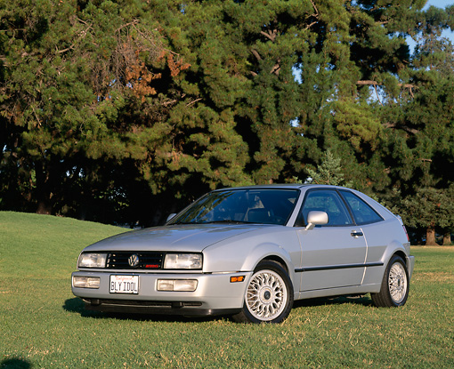 AUT 25 RK1155 03 © Kimball Stock 1992 Volkswagen Corrado SLC Silver Front 3/4 View On Grass By Trees