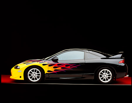 AUT 25 RK1170 09 © Kimball Stock 1999 Mitsubishi Eclipse GSX Custom Hot Rod Black With Flames Profile On Gray Line Red Floor Studio