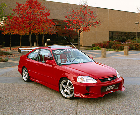 AUT 25 RK1180 04 © Kimball Stock 1999 Honda Civic EX Coupe Red 3/4 Front View On Pavement By Building