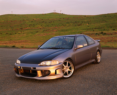 AUT 25 RK1189 02 © Kimball Stock 1995 Honda Civic EX Coupe Silver Black Hood 3/4 Front View On Pavement Grass Hills